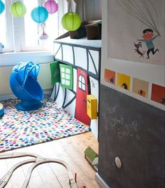 Lots of hide and seek spots in this colourful kids' room | LÖMSK chair | Chalkboard wall | Playtime | See more of Antje's home in Germany at live from IKEA FAMILY
