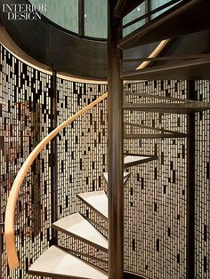 Lewis.Tsurumaki.Lewis Designs an Uptown Town-House | Part of the first of the town house's two renovations, a spiral stair, enclosed by a screen of laser-cut blackened steel, connects the three garden facing levels.