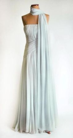 Designed by Catherine Walker for the Princess of Wales, she wore this gown to the Cannes Film Festival in 1987. Pale blue chiffon with matching stole was inspired by Grace Kelly. The gown is lot 6 and it raised $ 70,700 for Diana's charities.