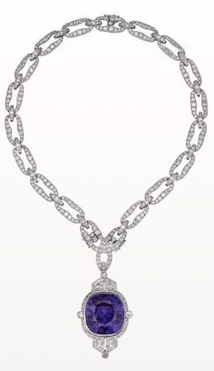 An exceptional Art Déco necklace in platinum set with diamonds. The pendant is…