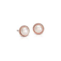Exemplify refined elegance with these freshwater-cultured pearl earrings, showcasing a detailed twisted roping forged of 14k rose gold.