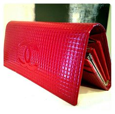 """Modern Red Clutch High gloss, faux leather, bold red clutch with embossed chanel logo on front and imprint inside. Detachable chain. Clasp change pocket and accordion compartment inside. Built in sleeves for credit cards. Fits my Nexus5 smart phone as long as its not wearing a bulky case. Length 7.25"""" by 3.5"""". Used once, excellent condition, I just never think to use it... Bags Clutches & Wristlets"""