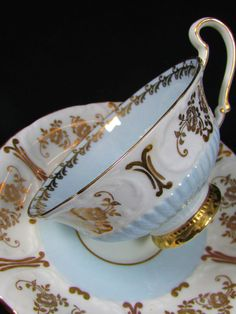 FOLEY BABY BLUE RIBBED EMBOSSED GOLD FLORAL TEA CUP AND SAUCER