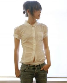 Ellen Page. LOVE her, love her style, and this pic is totally what I would wear if trying to be girly, lol. Jeans, cute top, messy updo. LOVE.