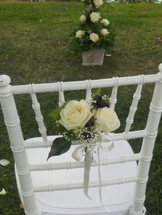 Flower arrangments on the chairs