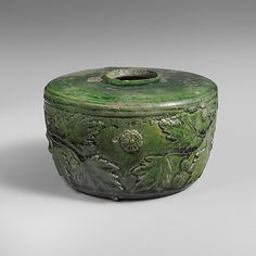 Terracotta atramentarium (inkwell) Period: Early Imperial, Julio-Claudian Date: 1st half of 1st century A.D. Culture: Roman Medium: Terracotta; lead-glazed Dimensions: H. 2 3/16 in. (5.6 cm) diameter 3 3/8 in. (8.6 cm) Classification: Vases