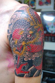 http://www.tattooers.net/tattoo/565/tattoo-shoulder-japanese-dragon.JPG