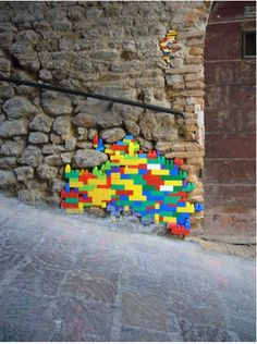 Awesome repair! Street artist or Lego-fan House Builder? #lego #art #cool