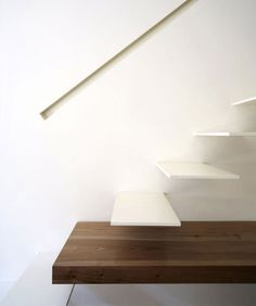 floating stairs, recessed handrail, landing+table