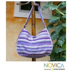 @Overstock - Handcrafted Cotton 'Violet Synchronicity' Hobo Bag (Guatemala) - Lush shades of lilac, purple and violet dance in this beautiful hobo bag, woven on a backstrap loom by the women of Maya Traditions. With two pockets, one with a zipper, the bag fastens with a coconut shell button.  http://www.overstock.com/Worldstock-Fair-Trade/Handcrafted-Cotton-Violet-Synchronicity-Hobo-Bag-Guatemala/7744184/product.html?CID=214117 $49.99