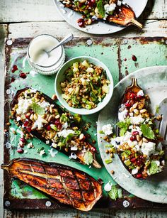 Baharat-spiced baked aubergines with feta, fennel and spelt - This recipe takes the humble aubergine to new heights, topped with a summery mix of spelt, fennel, mint and feta, and jewel-like pomegranate seeds