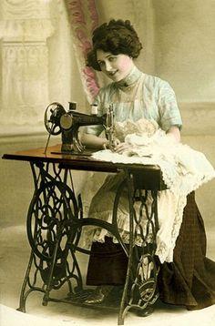 Classic seamstress at work photo. (1902)