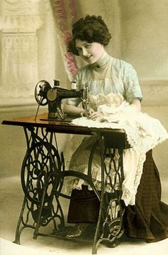 Classic seamstress at work photo. (1902)