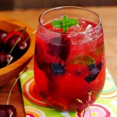 Skinny Cherry Berry Smash is fresh cherries, blueberries, mint & lime muddled with dark rum. All for under 120 calories!