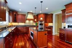 Image result for cherry cabinets with hardwood floors