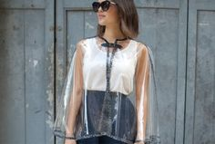 DIY Chic Poncho : piece of plastic cut to fit, outline with patterned duct tape, add a clasp.