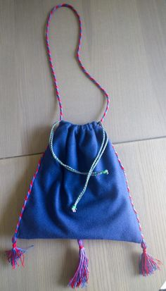 Wool Medieval Purse with tubular tablet woven carrying cord and fingerloop braided drawstrings