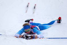 Iivo Niskanen of Finland collapses on the snow after competing in the Men's 15 km Classic (c) Getty Images