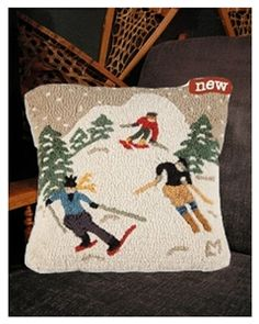 Wool pillow with skiers