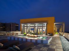 An inspired combination of fire and water is the centerpiece of this penthouse patio and sets the mood for a relaxed evening under the stars.