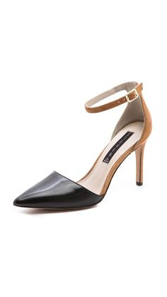"""Perfect black + nude pumps to add a little interest to conservative get-ups. Imagine a slim tailored black pantsuit with a little surprise of an """"invisible heel."""" Beautiful and effortless"""