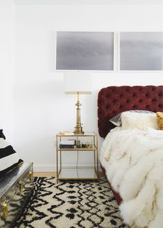the cozy bedroom of homepolish founder noa santos with rich burgundy headboard, fur comforter, and lots of light and white // via coco+kelley