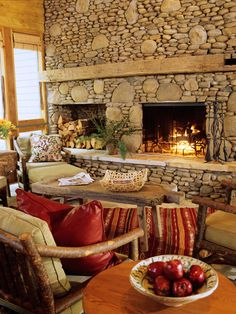 Unusual and very attractive large and small stone fireplace hearth and over mantel! Very creative.