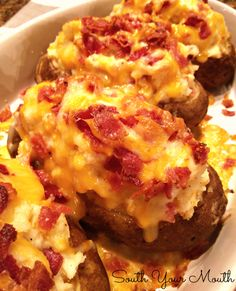 Mile-High Twice Baked Potatoes mounded mile high with cream cheese, butter, bacon and cheese!