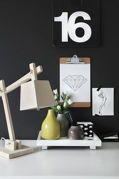 Muuto - Wood lamp. Against a confident grey wall.. Love.