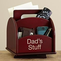 Gift Idea For Men`s  Revolving Wood Organizer   A great gift for your hard working dad! In the office or at home keep all his stuff organized. A sleek way to keep handy cell phones, video remotes and TV/cable remotes. Lined with felt it features 6 compartments and a swivel base. We laser engrave any 2 line message, up to 12 characters per line. Rich rosewood finish. #Xmas #Xmas2016 #XmasFun #ILoveXmas #XmasRecipes