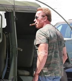 Still got it! Arnold Schwarzenegger looked every bit the tough Terminator that he was back in the 80s as puffed away on a cigar while standing next to his Hummer. via MailOnline