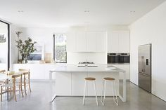 A renovation & a fresh white open-plan addition to an older style home … love the polished concrete floors in the new area, & the full height black sliding doors/windows .. providing a seamless connec