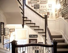 """Amazing staircase wall grouping - custom frame family photos and hang them so you're """"traveling through time"""" when you go up or down the stairs :-)"""