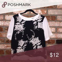 Flowered Blouse Black and white flower blouse. Worn once. Short sleeve. Zipper back. Scoop neck. Harlowe & Graham Tops Blouses