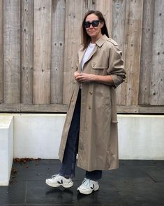 Trench coat and sneakers | For more style inspiration visit 40plusstyle.com