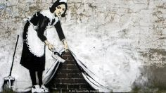 Sweeping it Under the Carpet (2006) by Banksy (Credit: Credit: Jim Dyson/Getty Images)