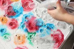 kids spraying baking soda with vinegar