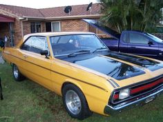 """My 1970 Chrysler Valiant Pacer Hardtop. Australian made Valiant, the hardtop's are very similar to a '68 Dodge Dart from the firewall back.  1970 was the first year for the 6-cylinder Hemi 245.  Mine has a few mods - 4-speed gearbox from a Charger, bored .060"""", mild cam, 4-barrel manifold and carb, and E49 style headers. Plymouth Scamp, Chrysler Charger, Chrysler Valiant, Plymouth Muscle Cars, Australian Cars, Dodge Dart, Sweet Cars, Train Car, Nice Cars"""
