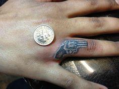 Eddie Martinez, Super Genius Tattoo, Seattle WA, black and grey tattoo, finger tattoo. revolver, gun, tiny tattoo