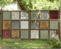 Recycled metal fence from tin and corrugated metal parts - cool