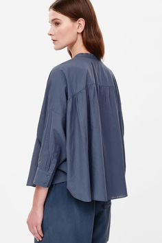 This oversized tunic top is made from extra-soft cotton voile with a sheer quality and subtle striped design. Designed to fall loosely on the body, it has extra-wide kimono sleeves, partial hidden button fastening and a softly curved hemline.