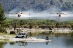 Firefighting planes fetch water from the Beniares reservoir to fight a wildfire next to the Sierra Mariola Nature Park in Cocentaina, Spain. July 13, 2012