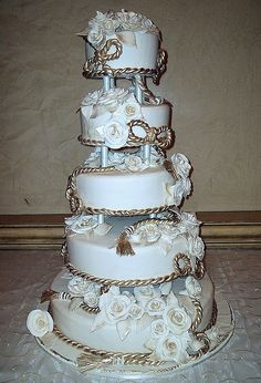 4 tier wedding cake with gold white chocolate rope