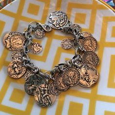 Stunning Silpada Coin Bracelet Stunning Silpada coin bracelet. This gorgeous bracelet is quite the statement piece. Intricate design details on each of the coins and the entire thing is .925 Sterling silver. Lobster clasp closure. In excellent condition. Silpada Jewelry Bracelets