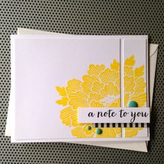 another card with the focal point cut in pieces--gives it a totally different look (love the enamel dots!)