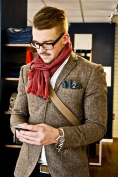 Shop this look for $283: http://lookastic.com/men/looks/pocket-square-and-messenger-bag-and-scarf-and-dress-shirt-and-belt-and-blazer/639 — Olive Polka Dot Pocket Square — Brown Messenger Bag — Red Polka Dot Scarf — White Dress Shirt — Brown Leather Belt — Grey Wool Blazer