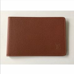 """💯Authentic Louis Vuitton Taiga Leather Card Case Authentic UNISEX brown Louis Vuitton Taiga horizontal leather pass card case. Date code SP0011, made in France (shown under the plastic so it's hard to take a picture of). Minor scratches and dirt marks on the clear case. Perfect to store pictures, cards, etc. Case came inside a Louis Vuitton wallet, but wallet was sold separately. Size approx W 4.9"""" x H 3.3"""". NO TRADES! Lower $ thru 🅿🅿✔or Ⓜercari✔ Louis Vuitton Bags Wallets"""