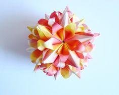 Blooming Island kusudama Designer: Vladimir Frolov Paper size: 4.5*9 сm (1*2) Final height: ~7.5 cm Without glue