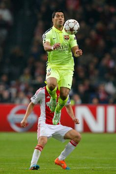 Luis Suarez of Barcelona controls the ball during the UEFA Champions League Group F match between AFC Ajax and FC Barcelona at The Amsterdam Arena on November 5, 2014 in Amsterdam, Netherlands.