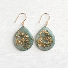 A personal favorite from my Etsy shop https://www.etsy.com/listing/230521699/green-and-gold-leaf-earrings-gold-leaf